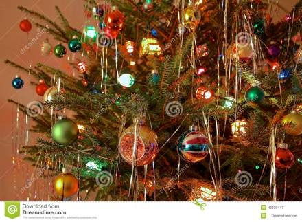 kitsch-s-style-decorated-christmas-tree-close-up-antique-glass-baubles-coloured-lights-retro-46636447.jpg